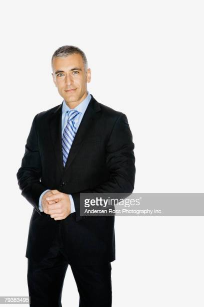 Middle Eastern businessman with hands clasped