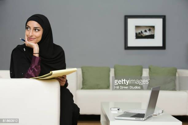 Middle Eastern businesswoman holding notepad