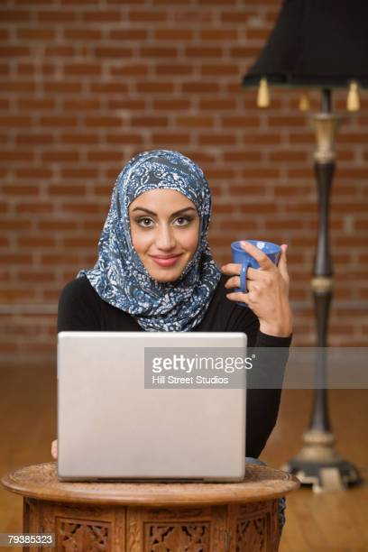 Middle Eastern businesswomen with laptop