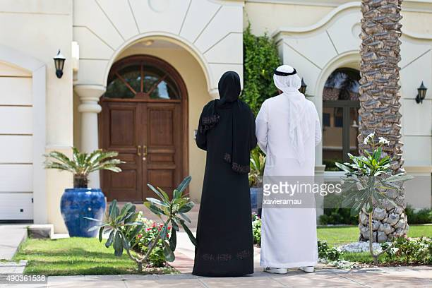 Middle Eastern couple looking their new home