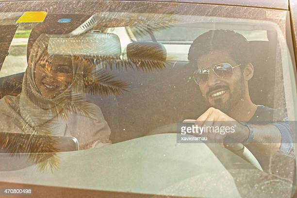 Middle Eastern couple travelling by car