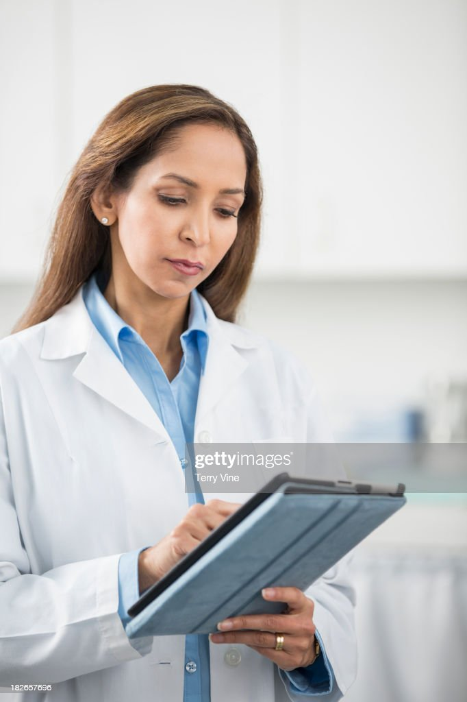 Middle Eastern doctor using tablet computer in office : Stock Photo