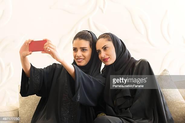 Middle Eastern Emirrati Women Taking Selfie in Modern White Room
