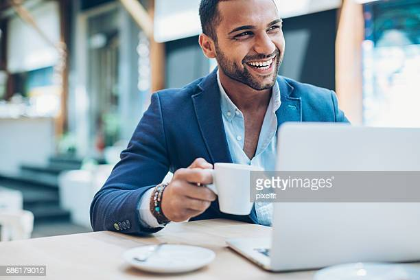 Middle Eastern ethnicity businessman in cafe