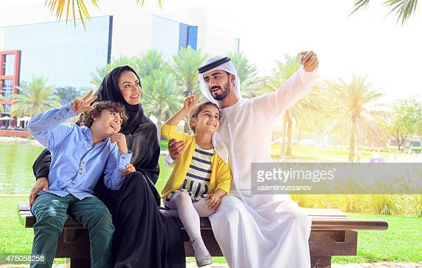 Middle Eastern family take a selfie using mobile phone