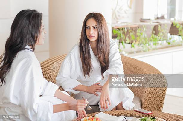 Middle Eastern Girlfriends in Bathrobes Having Healthy Spa Vegan Breakfast