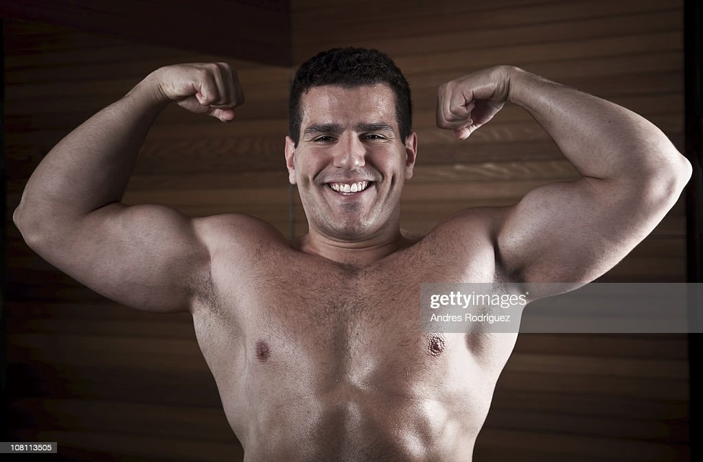 Middle Eastern man flexing biceps : Stock Photo