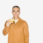 Middle Eastern man holding up drink
