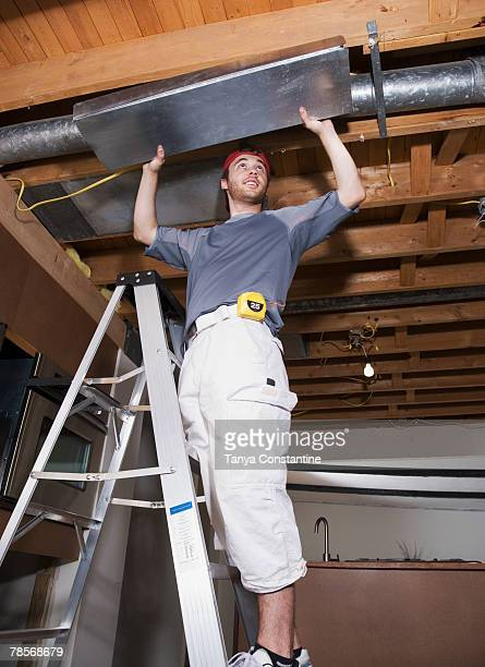 Middle Eastern man remodeling house