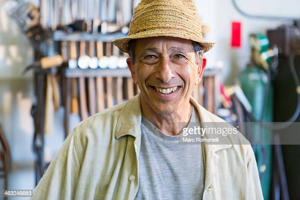 Middle Eastern man smiling in workshop