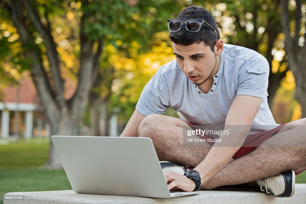 Middle Eastern man using laptop