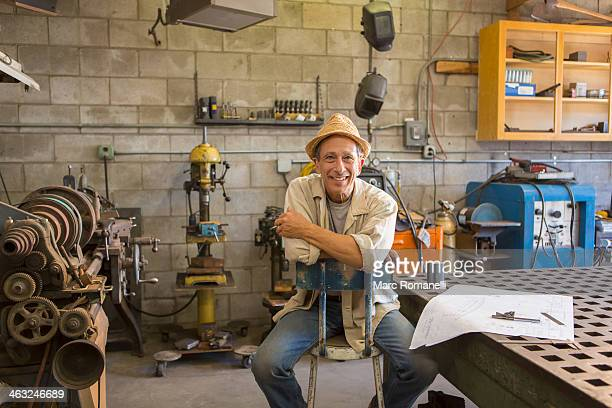 Middle Eastern man working in workshop