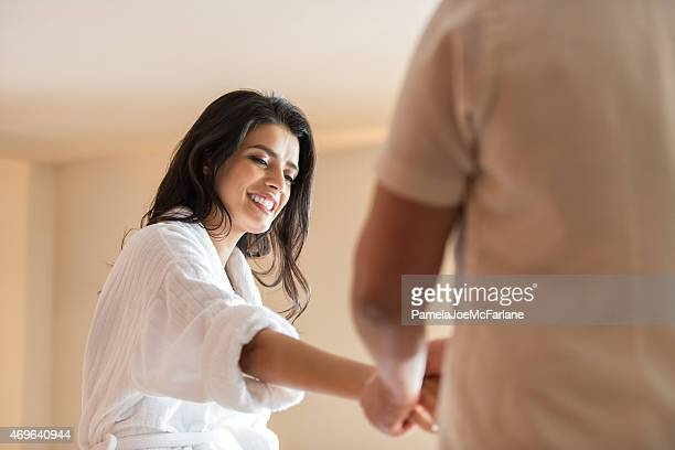 Middle Eastern Woman in Bathrobe Enjoying Hand Massage from Therapist