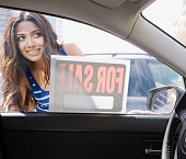 Middle Eastern woman looking at car for sale