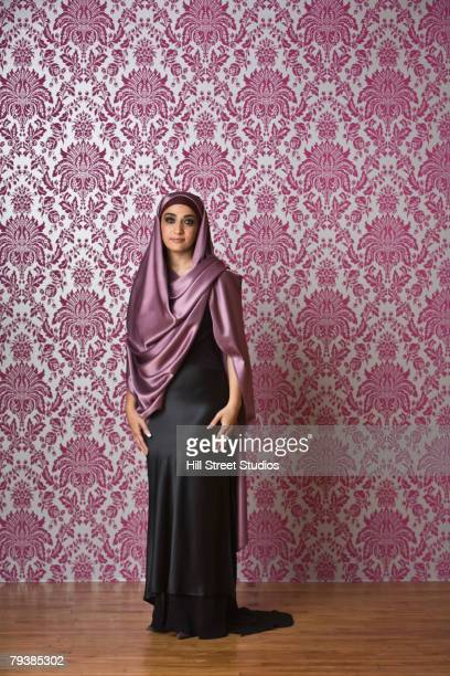 Middle Eastern woman wearing evening gown