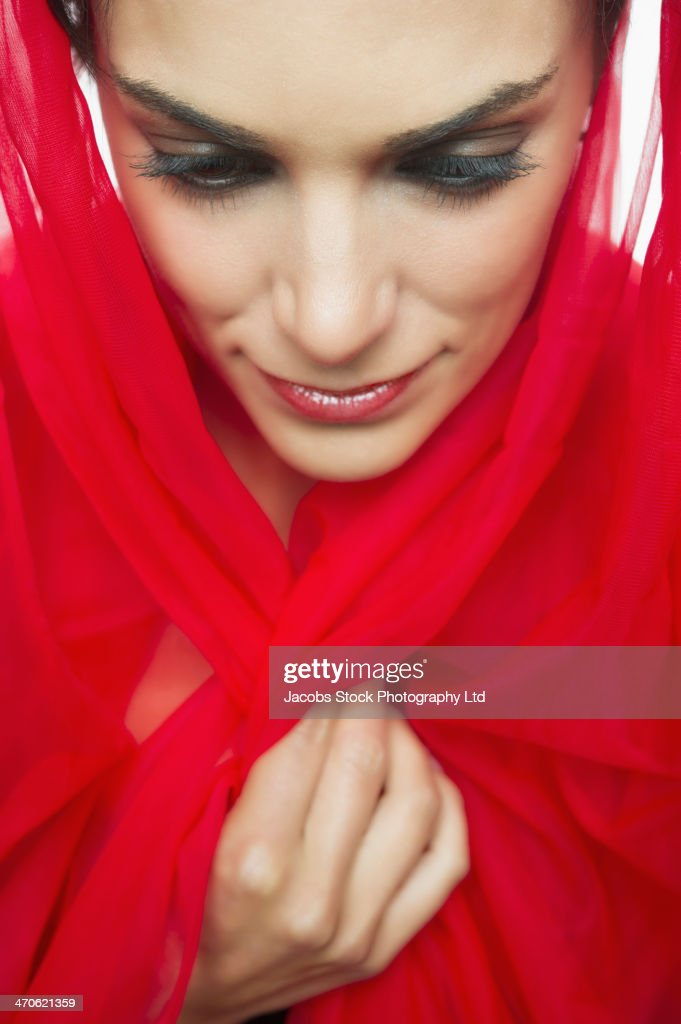 Middle Eastern woman wearing red hijab