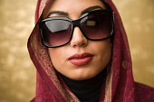 Middle Eastern woman wearing sunglasses
