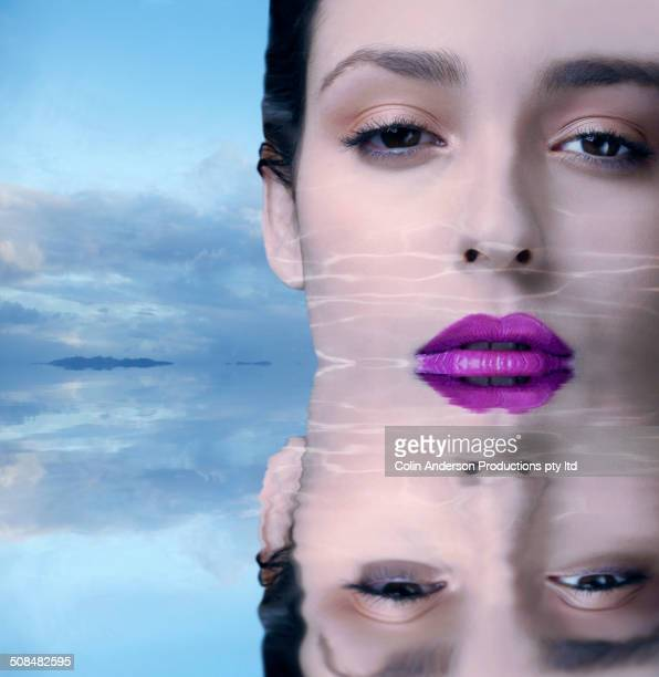 Middle Eastern woman's face reflected in water