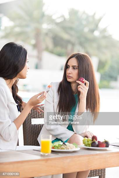 Middle Eastern Women Having Serious Discussion at Outdoor Spa Caf?