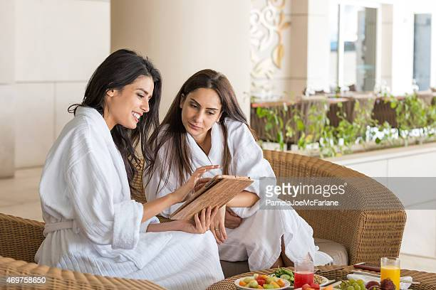 Middle Eastern Women with Computer Tablet Having Spa Meal Together