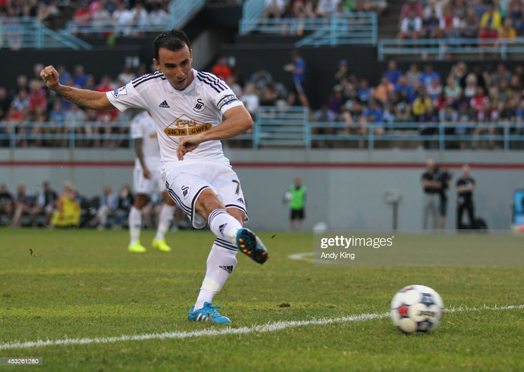 Middle fielder Leon Britton #7 passes the ball against Minnesota United FC on July 19, 2014 at the National Sports Center in Blaine, Minnesota. Minnesota United FC defeated Swansea City 2-0.