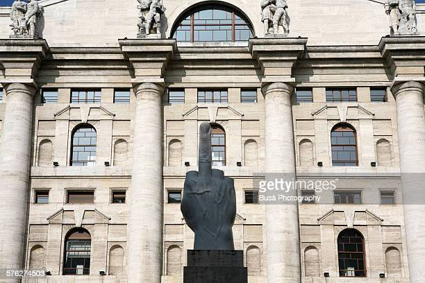Middle finger sculpture in front of Milan's Bourse
