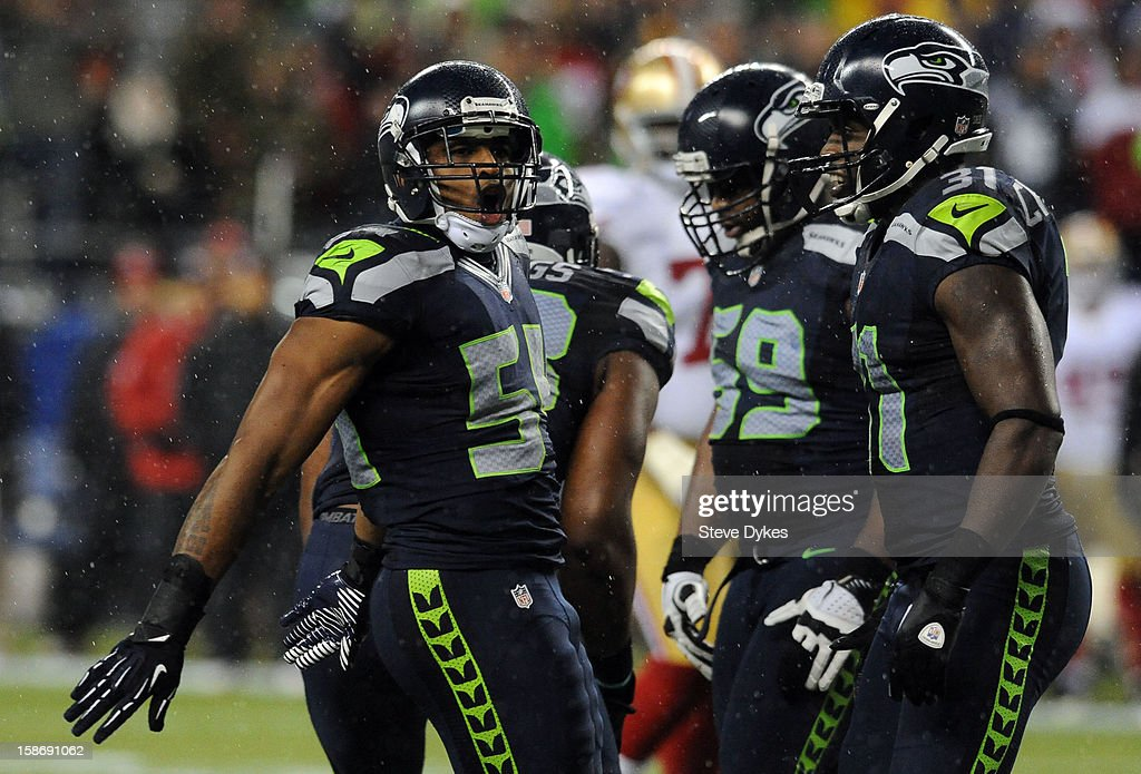 middle linebacker Bobby Wagner #54 of the Seattle Seahawks and strong safety Kam Chancellor #31 of the Seattle Seahawks celebrate after making a stop on third down during the second quarter of the game against the San Francisco 49ers at CenturyLink Field on December 23, 2012 in Seattle,Wa.