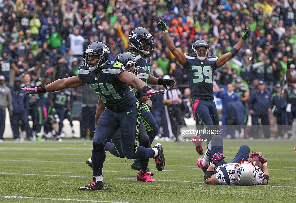 Middle linebacker Bobby Wagner #54 of the Seattle Seahawks celebrates after stopping wide receiver <a gi-track='captionPersonalityLinkClicked' href=/galleries/search?phrase=Wes+Welker&family=editorial&specificpeople=236127 ng-click='$event.stopPropagation()'>Wes Welker</a> #83 of the New England Patriots on fourth down on the Patriots' final possession at CenturyLink Field on October 14, 2012 in Seattle, Washington. The Seahawks defeated the Patriots 24-23.