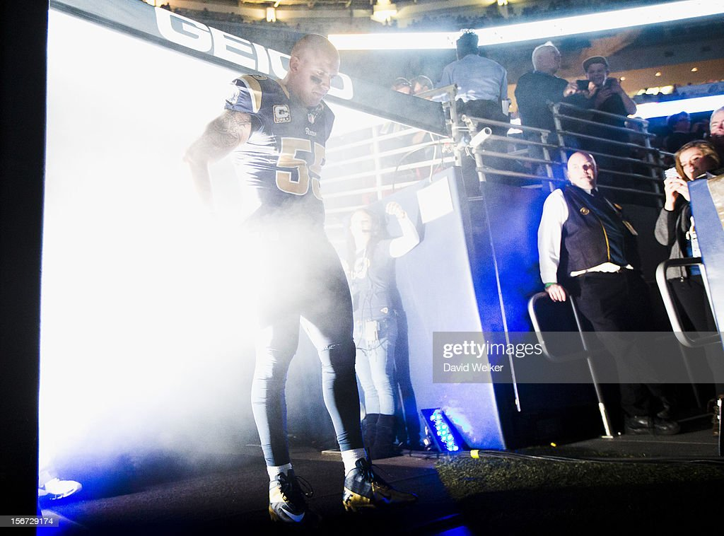 Middle linebacker James Laurinaitis #55 of the St. Louis Rams is illuminated by bright lights during player introductions during the game against the New York Jets at the Edward Jones Dome on November 18, 2012 in St. Louis, Missouri.