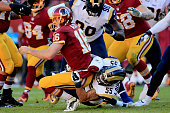 Middle linebacker James Laurinaitis of the St Louis Rams sacks quarterback Colt McCoy of the Washington Redskins in the second quarter of a game at...