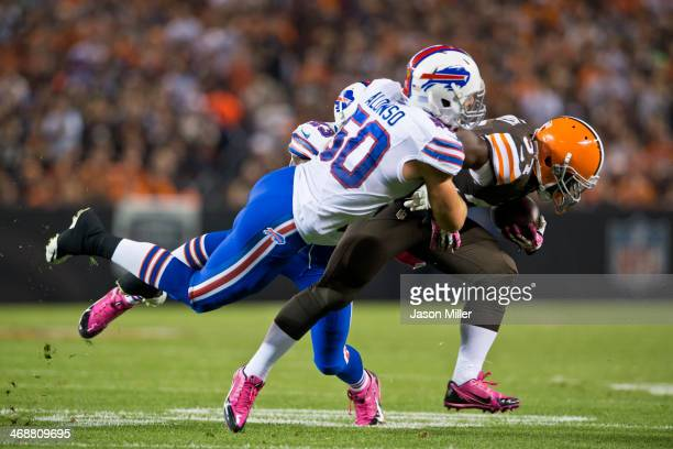 Middle linebacker Kiko Alonso of the Buffalo Bills tackles running back Bobby Rainey of the Cleveland Browns during the first half at FirstEnergy...