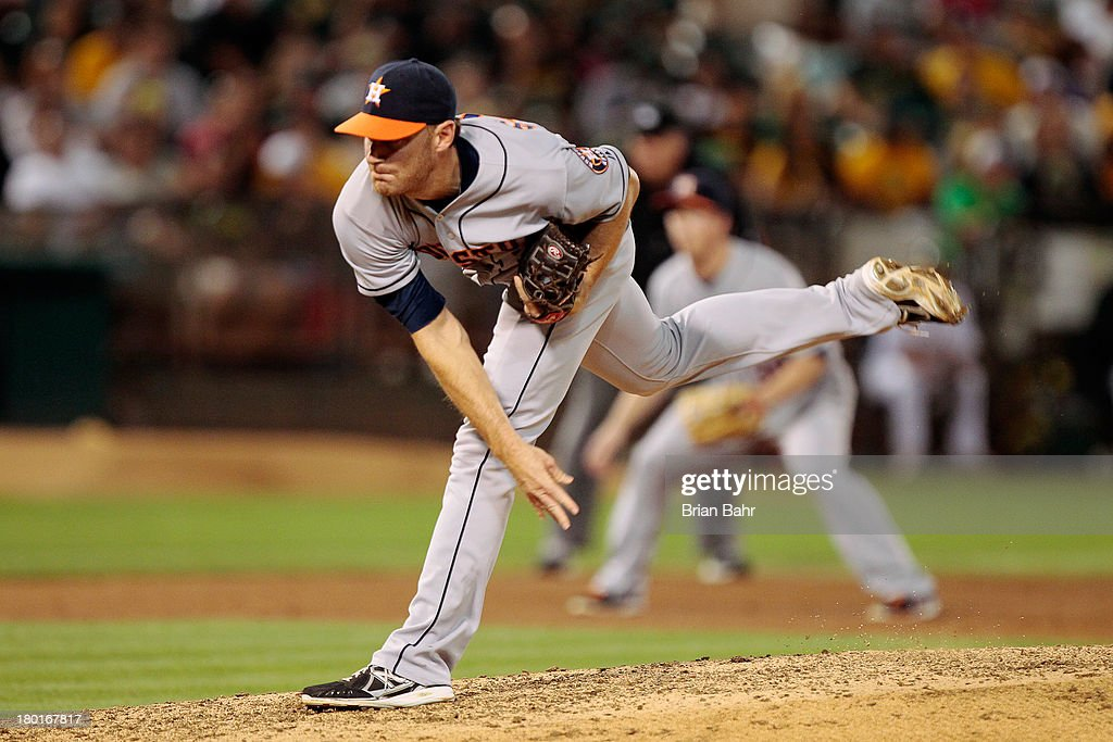 Middle relief pitcher <a gi-track='captionPersonalityLinkClicked' href=/galleries/search?phrase=Philip+Humber&family=editorial&specificpeople=836505 ng-click='$event.stopPropagation()'>Philip Humber</a> #21 of the Houston Astros follows through on a pitch against the Oakland Athletics in fifth inning at O.co Coliseum on September 6, 2013 in Oakland, California. The A's won 7-5.