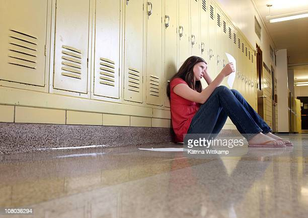 Middle school girl looking at classwork
