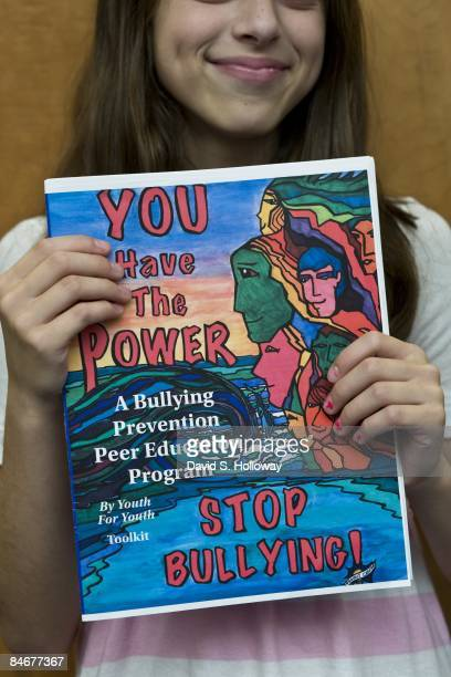 Middle School student Haley Nachlas shows the magazine students created with their high school mentors in the Project Change Program to educate...