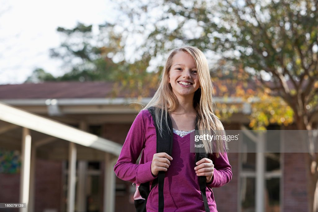 Middle school student outside with bookbag