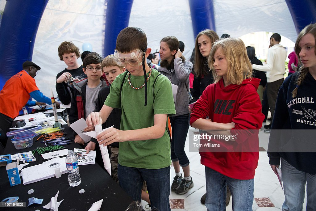Middle school students from Spring Ridge Middle School in St. Mary's County, Md., conduct an experiment with a paper rocket and effervescent tablets in Union Station as part of an Earth Day celebration sponsored by NASA.
