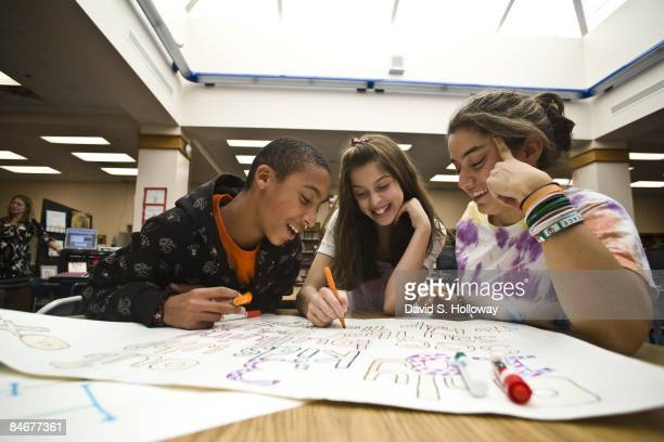 Middle schoolers Andres Araujo 12 and Haley Nachlas talk to Claire Hernandez their high school mentor as they discuss bullying and the Project Change...