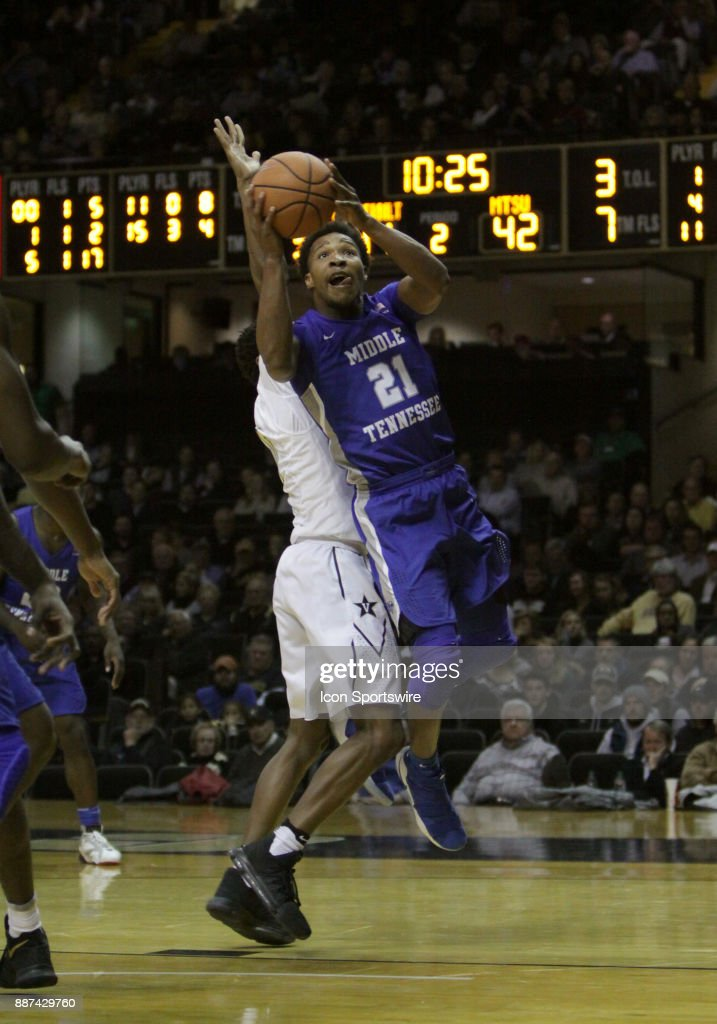 Middle Tennessee State Blue Raiders forward David Simmons (21) scores on a layup past a Vanderbilt Commodores defender during a college basketball game between the Middle Tennessee State Blue Raiders and the Vanderbilt Commodores on December 06, 2016 at Memorial Gym in Nashville, Tennessee.