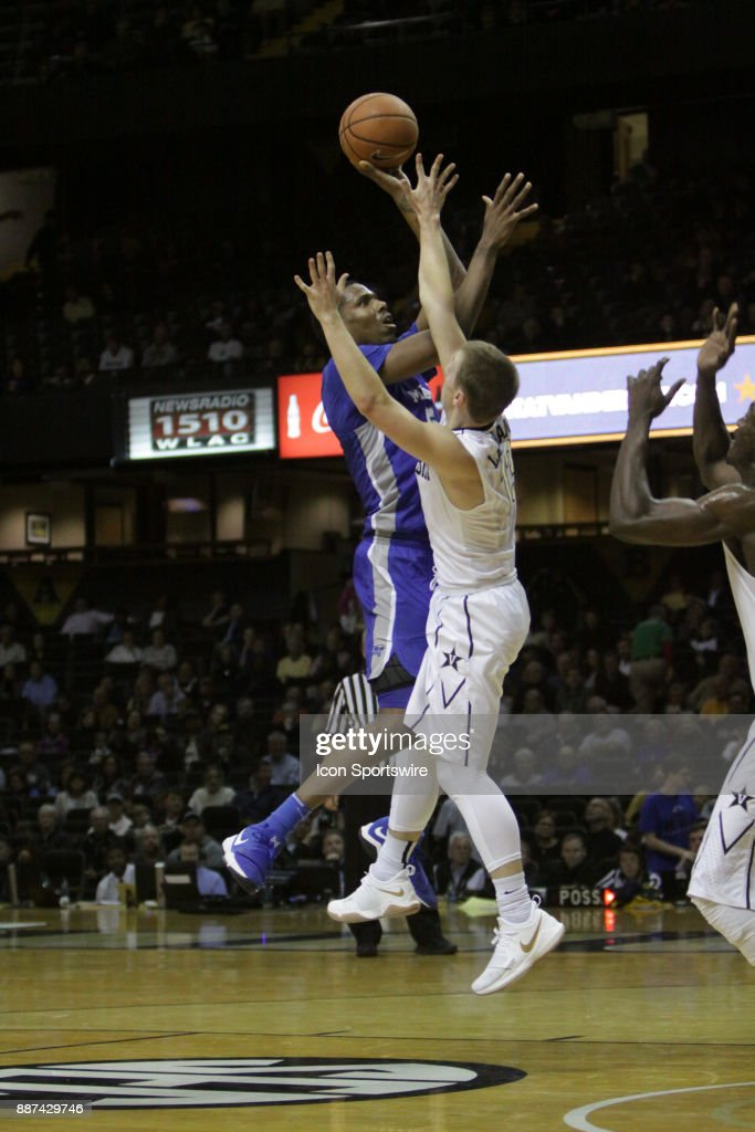 Middle Tennessee State Blue Raiders forward Nick King (5) shoots over Vanderbilt Commodores guard Riley LaChance (13) during a college basketball game between the Middle Tennessee State Blue Raiders and the Vanderbilt Commodores on December 06, 2016 at Memorial Gym in Nashville, Tennessee.