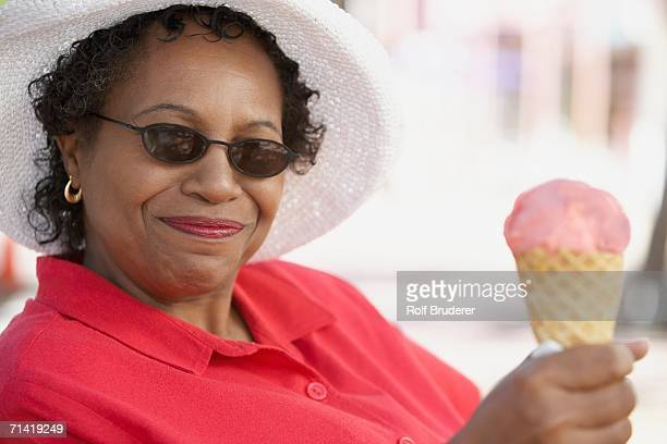 Middle-aged African woman with ice cream cone