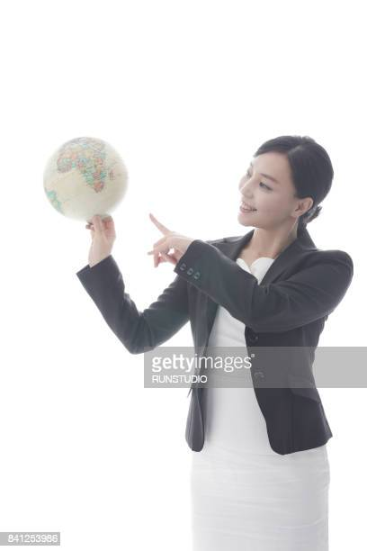 Middle-aged business woman holding a globe