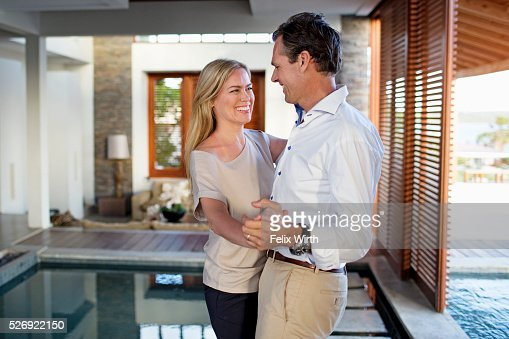 Middle-aged couple dancing at home : Stock Photo