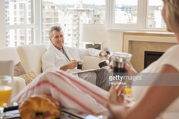 Middle-aged couple enjoying a leisurely morning