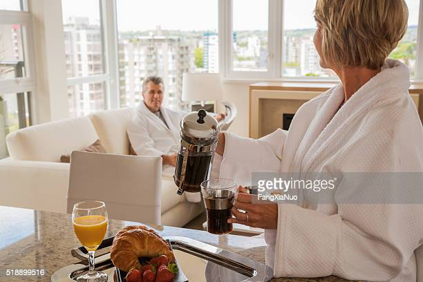 Middle-aged couple enjoying a leisurely morning