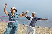 Middle-Aged Couple Hula Hooping