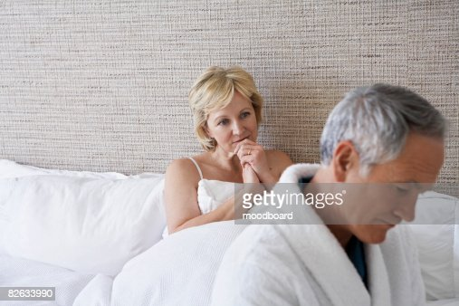Middle-aged couple in bedroom