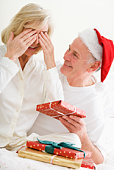Middle-aged couple with Christmas presents