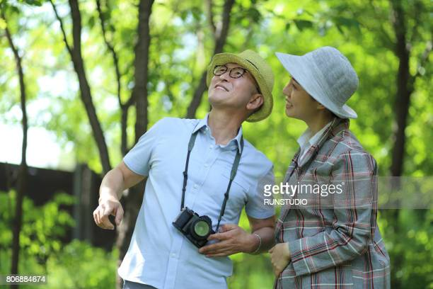 Middle-aged man enjoying hobby in the woods