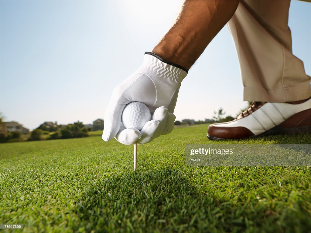 Middle-Aged Man Golfing
