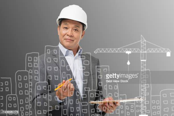 Middle-aged man holding a tablet recording data construction engineer